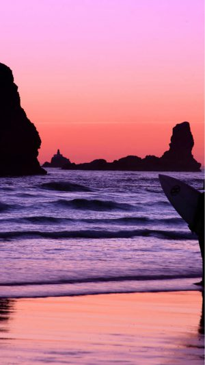 Surfer at Sunset, Cannon Beach, Oregon iPhone 7 wallpaper
