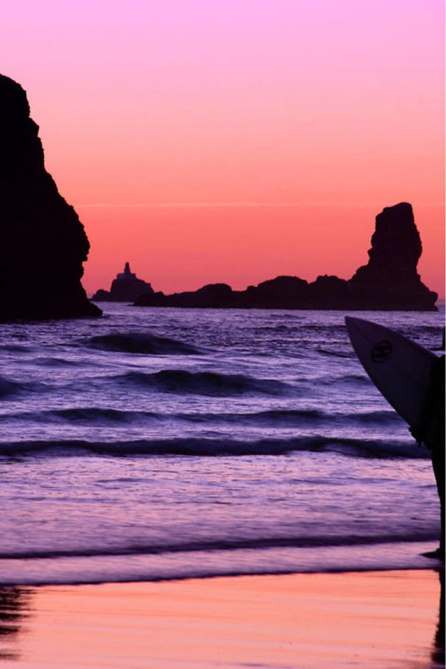 Surfer at Sunset, Cannon Beach, Oregon iPhone wallpaper
